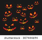scary carved pumpkins faces | Shutterstock .eps vector #307444694