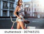 trendy hipster girl with bike...   Shutterstock . vector #307465151