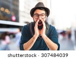 man shouting on unfocused... | Shutterstock . vector #307484039
