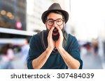man shouting on unfocused... | Shutterstock . vector #307484039
