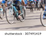 motion blurred biker in the city | Shutterstock . vector #307491419