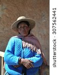 Small photo of ALTIPLANO, BOLIVIA - SEPTEMBER 10, 2010: Unidentified Bolivian woman with valleys Altiplano. Altiplano is a vast plateau in the Andes mountains.