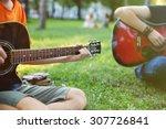 guys play guitars in city park... | Shutterstock . vector #307726841