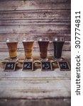 craft beer tasting  wood...   Shutterstock . vector #307774811