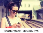young woman using her cell... | Shutterstock . vector #307802795