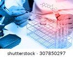 hands of clinician holding... | Shutterstock . vector #307850297