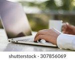 businessman working with laptop ...   Shutterstock . vector #307856069