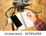 girl writes in notebook with... | Shutterstock . vector #307856084