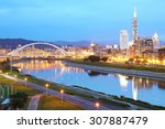 Small photo of Night scenery of Taipei City with beautiful reflections of skyscrapers and bridges on smooth water by riverside at dusk ~ Cityscape of Taipei 101, Keelung River, Xinyi District & downtown in twilight