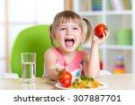 happy child girl eats dinner... | Shutterstock . vector #307887701