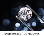 luxury diamond in tweezers... | Shutterstock . vector #307889945