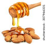 Small photo of honey dripping on almond nuts isolated on white background