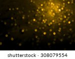 gold bokeh on black background | Shutterstock . vector #308079554