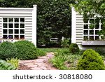Eloquent garden with walls for accent - stock photo