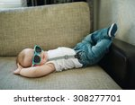 Stock photo cute little boy in sunglasses at home 308277701