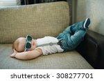 cute little boy in sunglasses... | Shutterstock . vector #308277701