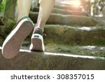 Woman Climbing Stone Steps To...
