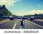 mountain biking down hill... | Shutterstock . vector #308384225