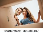 smiling young couple opening a... | Shutterstock . vector #308388107
