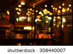 Stock photo table in blur pub or bar nightclub and restaurant at christmas night celebrate party with bokeh 308440007
