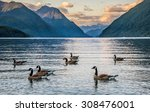 Mountains Around Lake With Geese