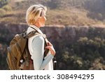 happy senior female hiker... | Shutterstock . vector #308494295
