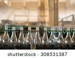many bottles on conveyor belt... | Shutterstock . vector #308531387