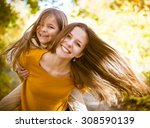 Two Cheerful Sisters Playing I...