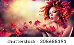 Autumn Woman Blowing Red Leave...