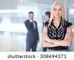 business woman standing in... | Shutterstock . vector #308694371