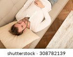 a young man meditating on the...   Shutterstock . vector #308782139