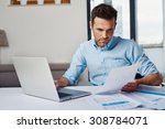 young man working with laptop... | Shutterstock . vector #308784071
