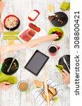 a family having breakfast at... | Shutterstock . vector #308800421