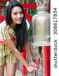 asian woman ringing a bell in a ... | Shutterstock . vector #308817854