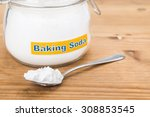 jar and spoonful of baking soda ... | Shutterstock . vector #308853545