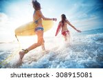 two ladies running into the sea ... | Shutterstock . vector #308915081