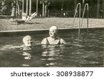 vintage photo of mother and... | Shutterstock . vector #308938877