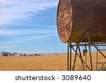 An Old Fuel Tank And A Field O...