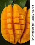 ripe mango  cube cut on banana... | Shutterstock . vector #308978795