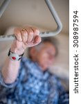 old woman holding the triangle... | Shutterstock . vector #308987594