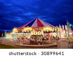 a merry go round stands idle... | Shutterstock . vector #30899641