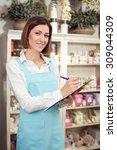 cheerful florist is standing... | Shutterstock . vector #309044309