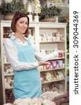 attractive florist is standing... | Shutterstock . vector #309044369