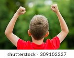 self confident boy with raised... | Shutterstock . vector #309102227