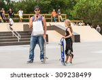 Small photo of ILHAVO, PORTUGAL - AUGUST 22, 2015: Nuno Alcaide delivering some prizes to Catarina Correia during the Ilhavo's Skateboarding Championship and the new skatepark opening.