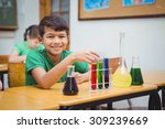 student using lab glassware at... | Shutterstock . vector #309239669