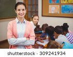 teacher smiling at camera in... | Shutterstock . vector #309241934