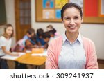 teacher smiling at camera in... | Shutterstock . vector #309241937