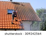 roof cleaning with high pressure | Shutterstock . vector #309242564