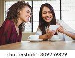 female friends having coffee... | Shutterstock . vector #309259829